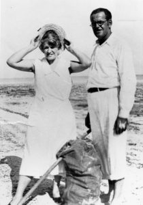 Ed and Fern Butters with a burlap sack filled with conch