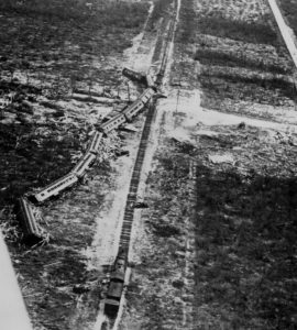 Toppled relief train, wreck intersected by Upper Matecumbe's De Leon Avenue
